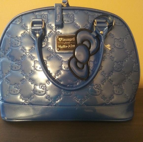 d863fb08f1 Blue Hello Kitty loungefly purse. M 5c2646fee944ba01215539d1